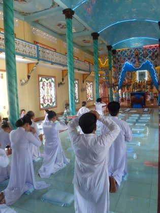 Worshippers in Cao Dai Temple