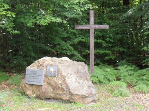 Memorial and cross at site of camp chapel, La Croix-Scaille
