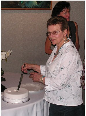 Joan cutting her 80th birthday cake