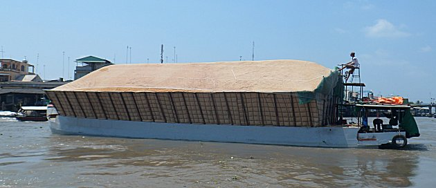 Barge carrying rice husks Mekong Delta