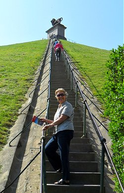 Sue about to climb the Lion Mound at Waterloo
